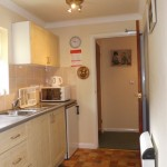 Fully fitted kitchen with microwave